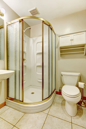 whie: Whie bathroom with tile floor and open glass door shower