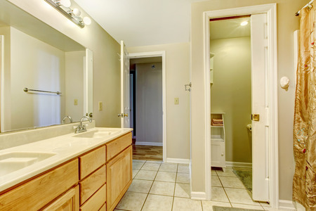 Empty bathroom with tile floor and vanity with mirror Stock Photo - 29033034