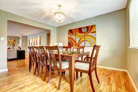 open floor plan: Open floor plan. View of dining area with table set and living room