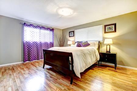 shiny floor: Bedroom with shiny hardwood floor, dark brown furniture set and purple curtain