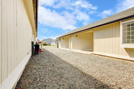 garage on house: House exterior  Backyard view of garage and driveway Stock Photo