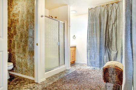 Spacious bathroom with tile floor and tile wall trim. View of shower door shower Stock Photo - 29386037