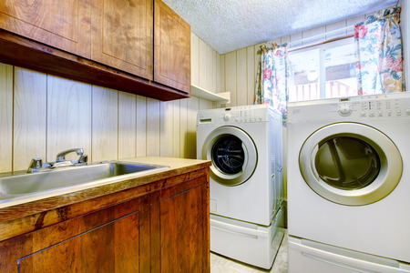Small laundry room with old cabinets and modern appliances photo