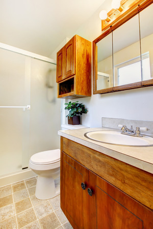 White small bathroom with bathroom vanity cabinet, toilet and screend tub Stock Photo - 29040536