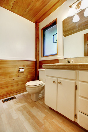 White and brown cozy bathroom with old bathroom vanity cabinet in log cabin house Stock Photo - 29378921