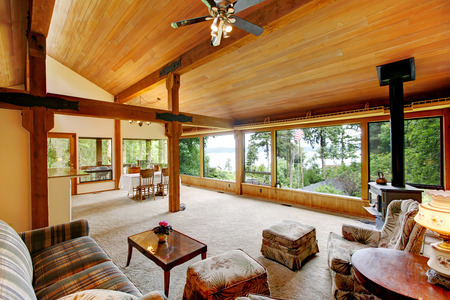 open floor plan: Open floor plan in log cabin house. View of living room and  dining area