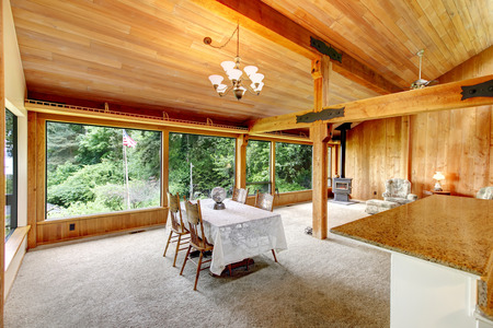 open floor plan: Open floor plan in log cabin house. View of living room with dining area