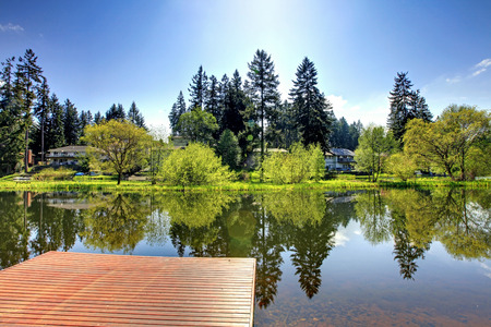 lake house: Beautiful view of lake and countryside houses from private dock on a sunny summer day