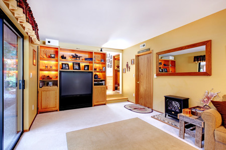 small room: Small living room if soft colors  View of cabinets with tv and wooden rustic table with fake fireplace