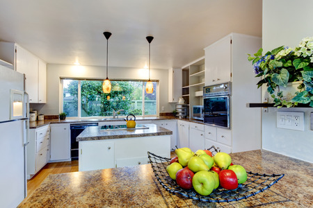 kitchen island: Kitchen room with white appliances, kitchen island and wide window