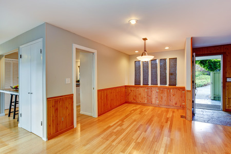 trim wall: Bright empty entrance hall with new hardwood and wooden plank wall trim