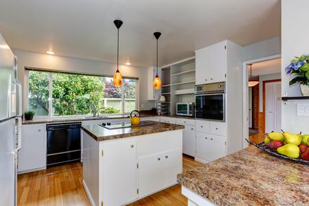 kitchen island: Kitchen room with white appliances, kitchen island and wide window