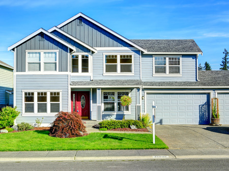 garage on house: House exterior with curb appeal Stock Photo