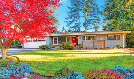 One story house with entrance porch and garage. View of driveway and curb appeal Stock Photo