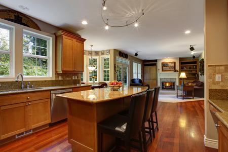 open floor plan: Open floor plan. View of elegant kitchen area with kitchen island Stock Photo