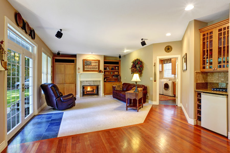 Cozy living room with fireplace and walkout deck photo