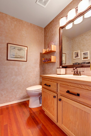 Bathroom interior  View of bathroom vanity cabinet with mirror and white toilet Stock Photo - 29688510