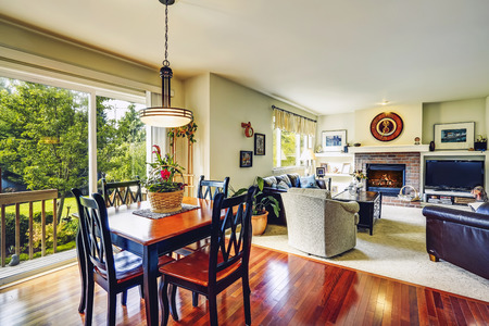 House interior  Open floor plan  View of living room with dining table set and open door to walkout deck Stock Photo - 29688511