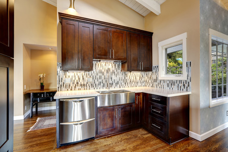 appliances: Kitchen storage combination in dark brown color with steel stainless appliances