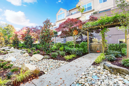 rock garden: Residential building with landscaped garden and walkway view Stock Photo