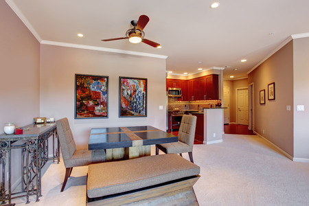 open floor plan: Open floor plan in modern apartment. View of dining area and bright burgundy kitchen room Stock Photo