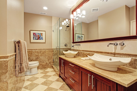 screened: Modern bathroom with glass screened shower and bathroom vanity cabinet with two white vessel sinks and mirror
