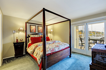 Bedroom interior with high pole bed and walkout deck photo