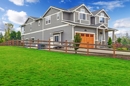 garage on house: House exterior. Big house with column porch, garage and driveway view
