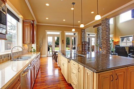 Spacious kitchen inteiror with kitchen island and dining area in luxury house photo