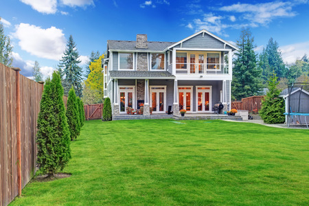 Luxury house with backyard walkout deck and  tramploline on the ground photo