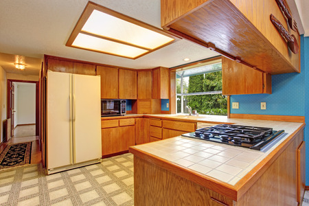 Bright kitchen room with skylight and linoleum. photo