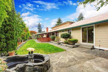 concrete: House exterior. View of garden with fountain