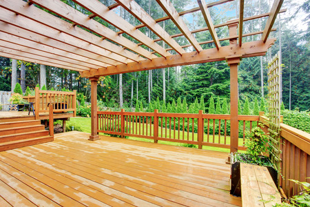 wooden deck: Spacious wooden deck with benches overlooking nature landscape Stock Photo