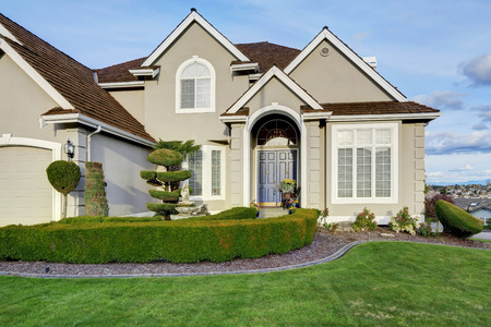 Luxury house with small entrance porch, walkway and curb appeal photo