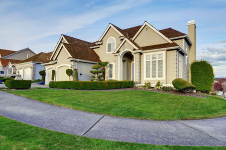 front view: Luxury house with small entrance porch, walkway and curb appeal Stock Photo
