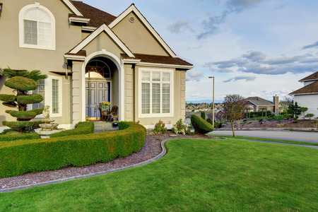 Luxury house with small entrance porch, walkway and curb appeal Stock Photo - 29938729