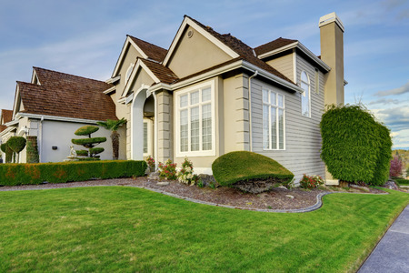 trimmed: Luxury house with small entrance porch, walkway and curb appeal Stock Photo