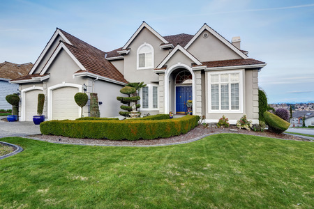Luxury house with small entrance porch, walkway and curb appeal Stock Photo