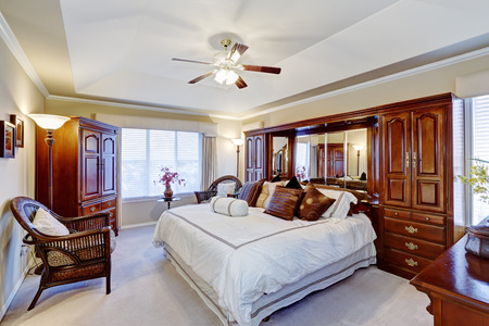 master bedroom: Luxury master bedroom interior with rich brown furniture set