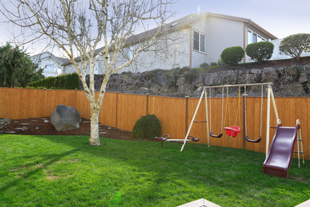 fenced: Fenced backyard with small playgound for kids