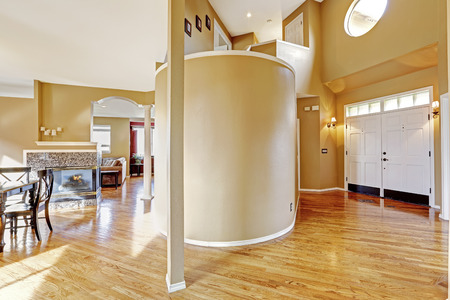 seperated: House inteior with open floor plan.View of entrance hallway seperated from main room with round wall