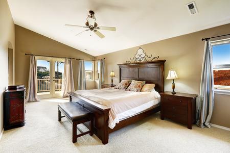 nightstands: Luxury bedroom interior with queen size bed, bench and nightstands. Stock Photo