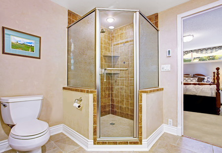 screened: Bathroom interior in light beige with screened shower and exit to master bedroom