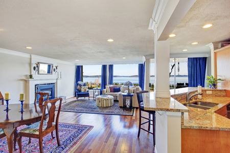 House interior with open floor plan. Living room with walkout deck, dining and kitchen area photo