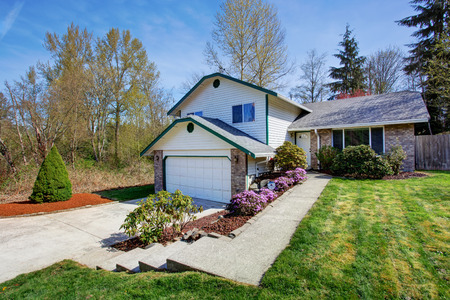 House exterior. View of driveway and landscape on front yard photo