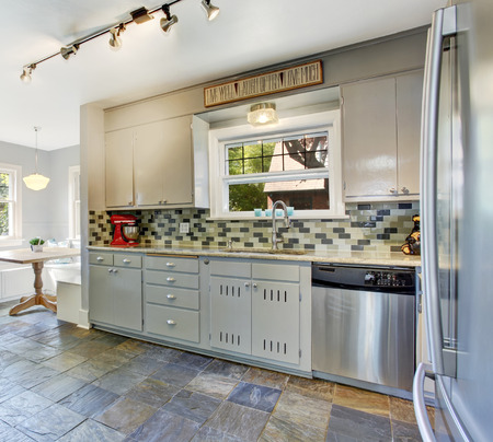 back kitchen: Kitchen room interior with bright dining area. View of tile back splash trim