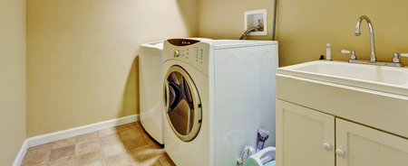 dryer  estate: Laundry room with old cabinet and modern appliances