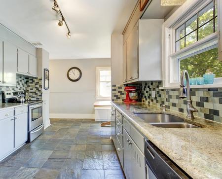 Kitchen room interior with tile back splash trim and tile floor