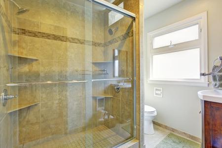 Modern bathroom interior with glass door shower photo