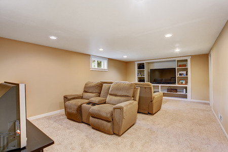 Cozy home theater in soft brown color with comfortable armchairs
